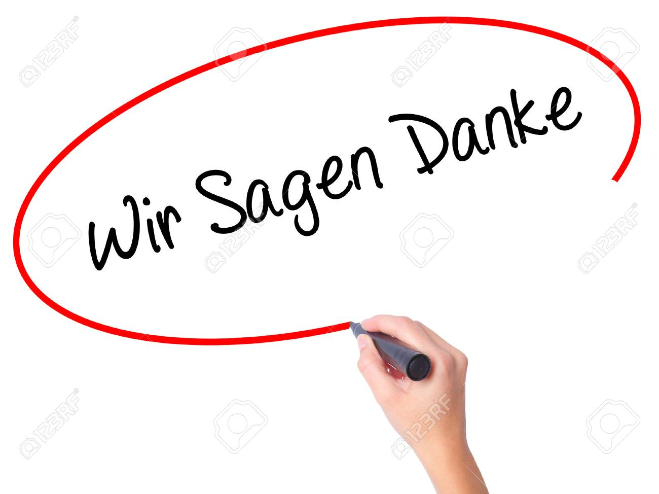 Women Hand writing Wir Sagen Danke (We Say Thank You In German) with black marker on visual screen. Isolated on white. Business, technology, internet concept. Stock Photo - 63178189