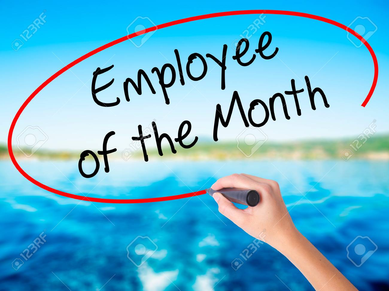 woman hand writing employee of the month on blank transparent