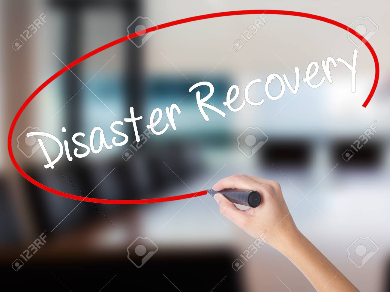 Woman Hand Writing Disaster Recovery with a marker over transparent board. Isolated on Office. Business concept. Stock Photo - 68054964