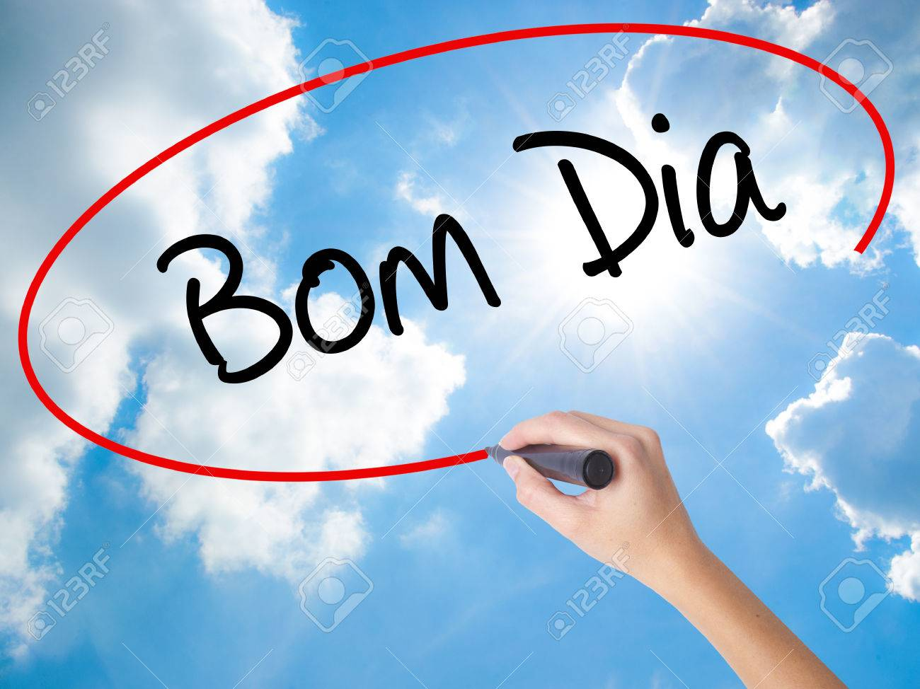 Woman Hand Writing Bom Dia In Portuguese Good Stock Photo