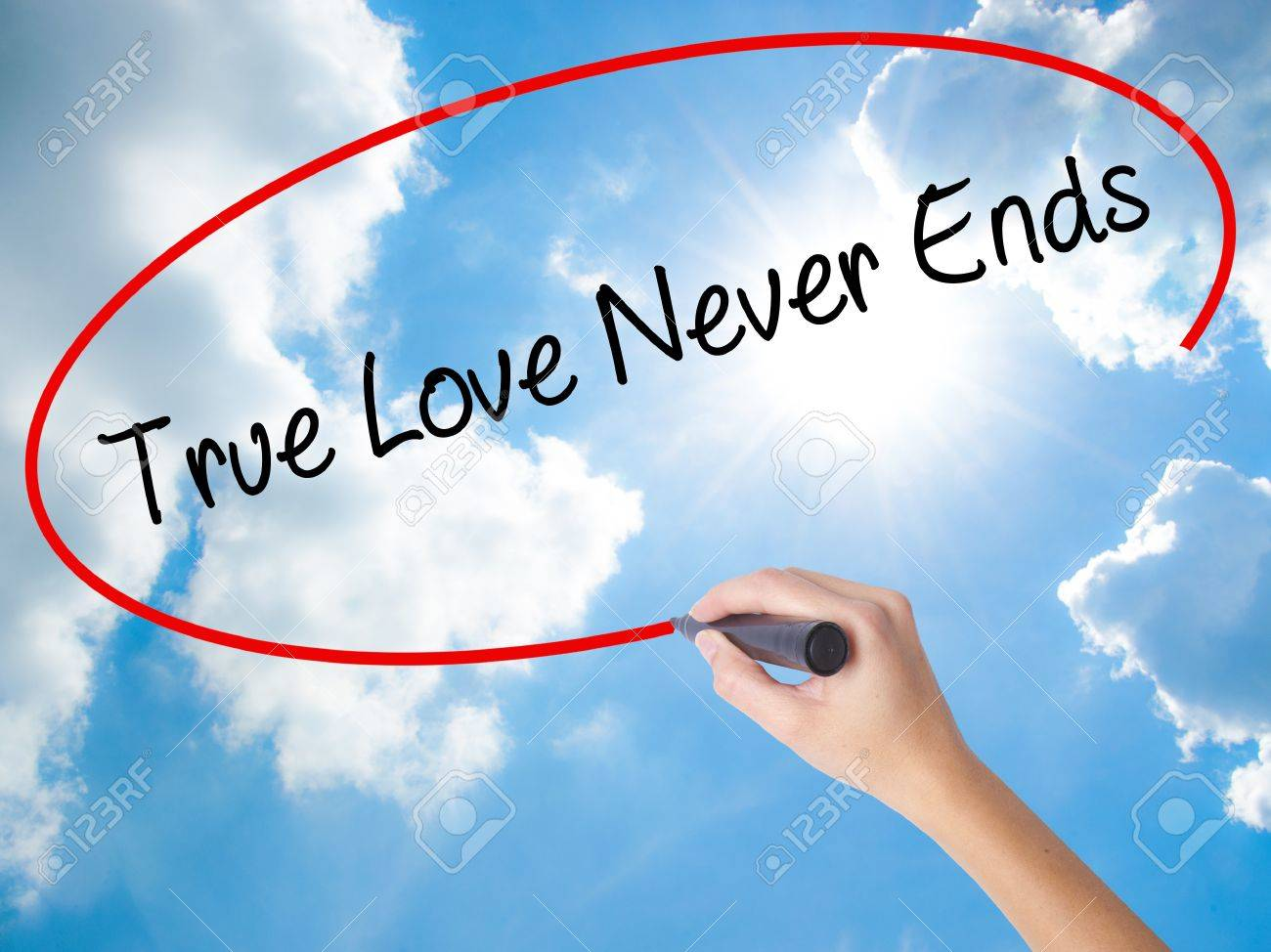 Woman Hand Writing True Love Never Ends With Black Marker On Stock