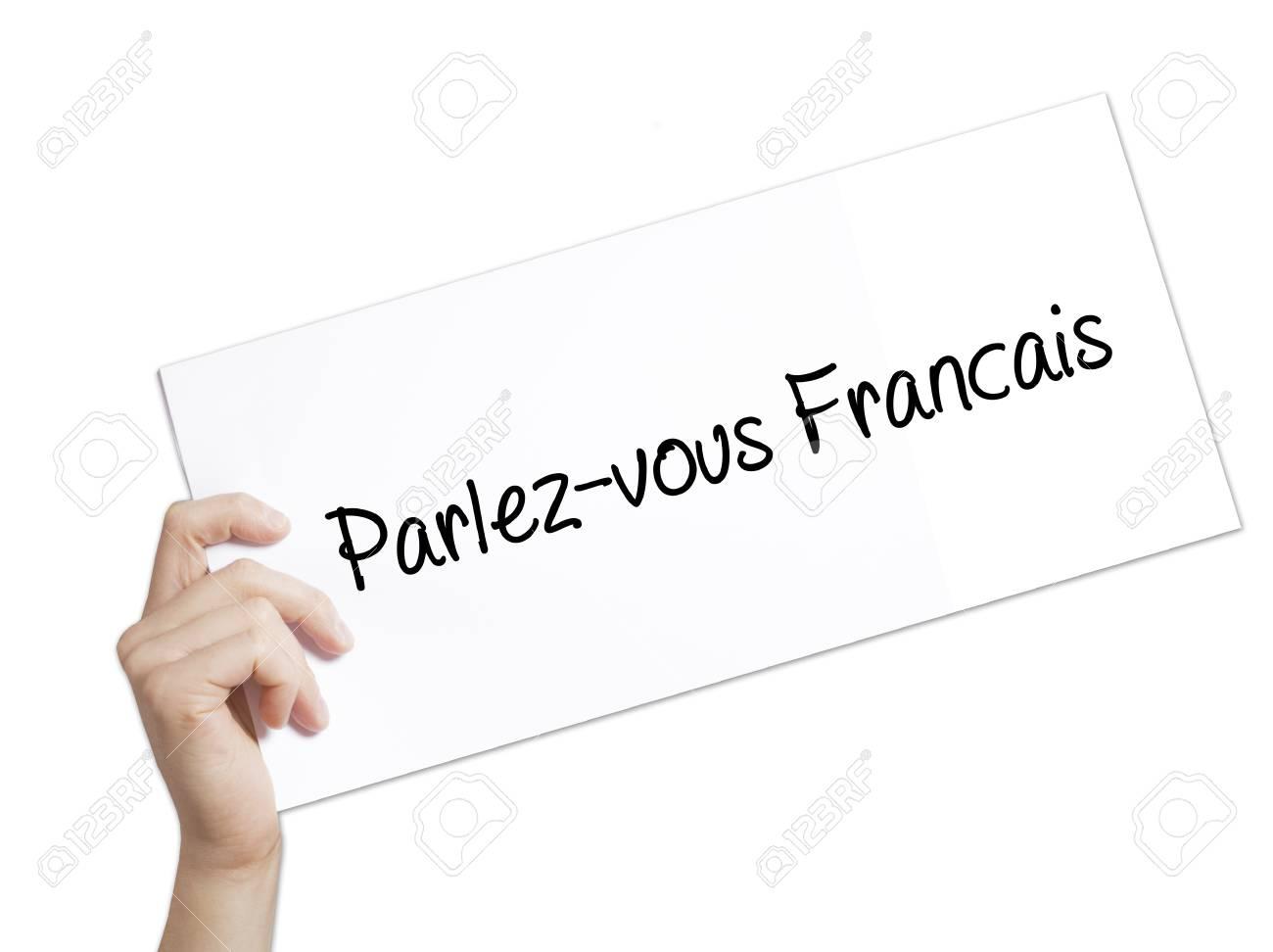 Parlez Vous Francais Signalez Vous Le Francais En Francais Inscrivez Vous Sur Un Livre Blanc Main De L Homme Tenant Le Papier Avec Du Texte Isole