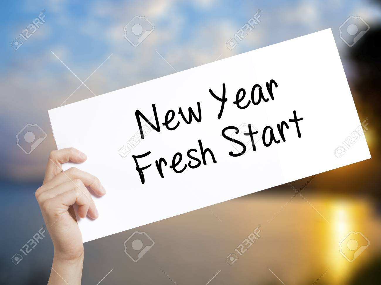 New Year Fresh Start Sign On White Paper. Man Hand Holding Paper ...