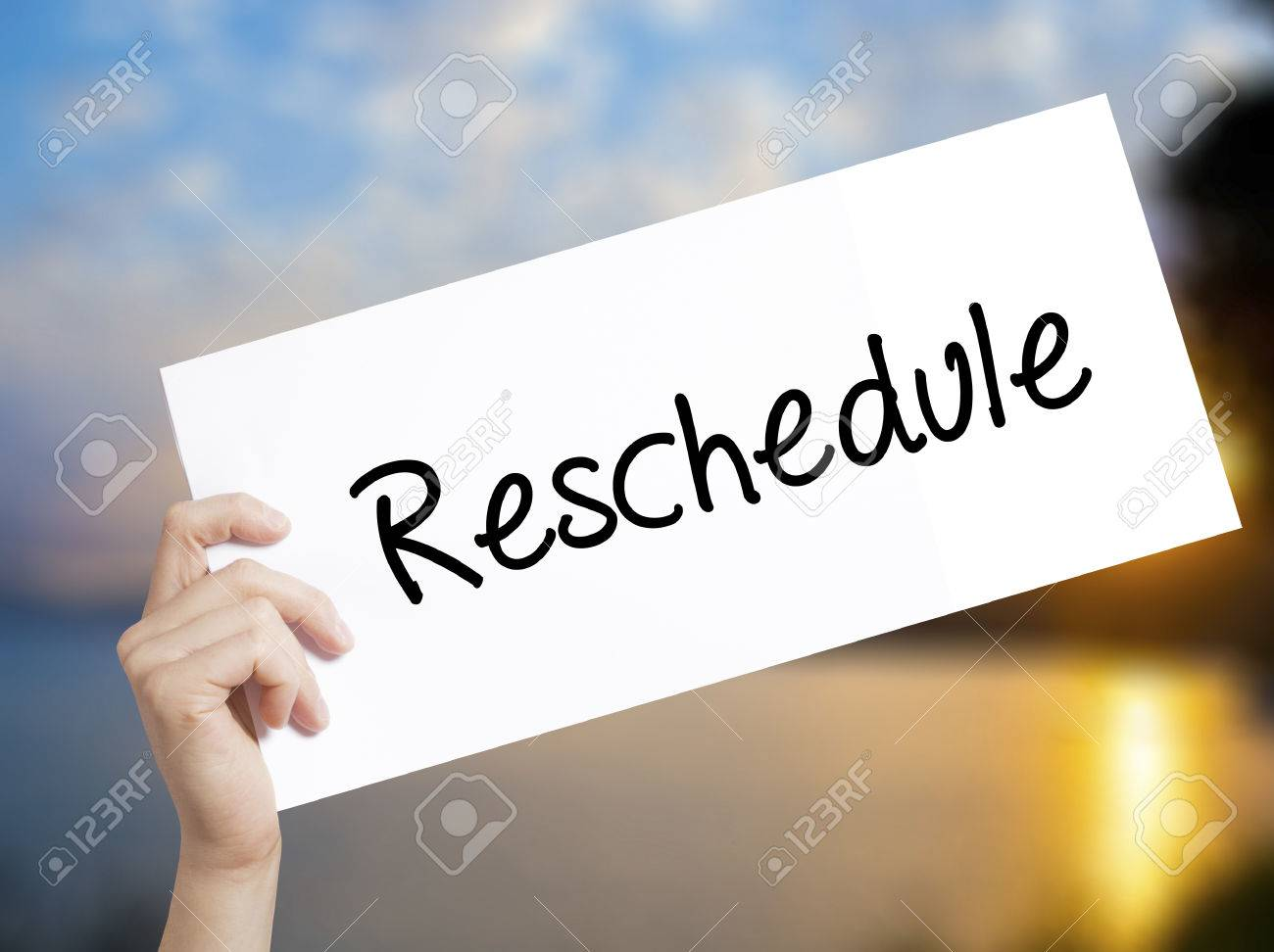 reschedule sign on white paper man hand holding paper with stock