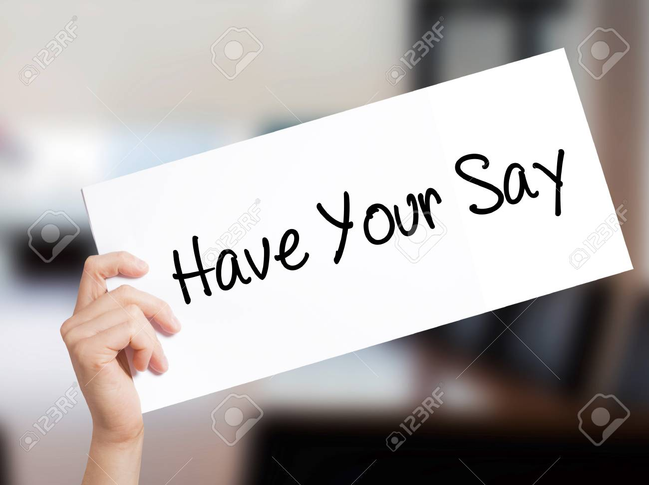 Have Your Say Sign on white paper. Man Hand Holding Paper with text. Isolated on Office background. Business concept. Stock Photo - 78209217