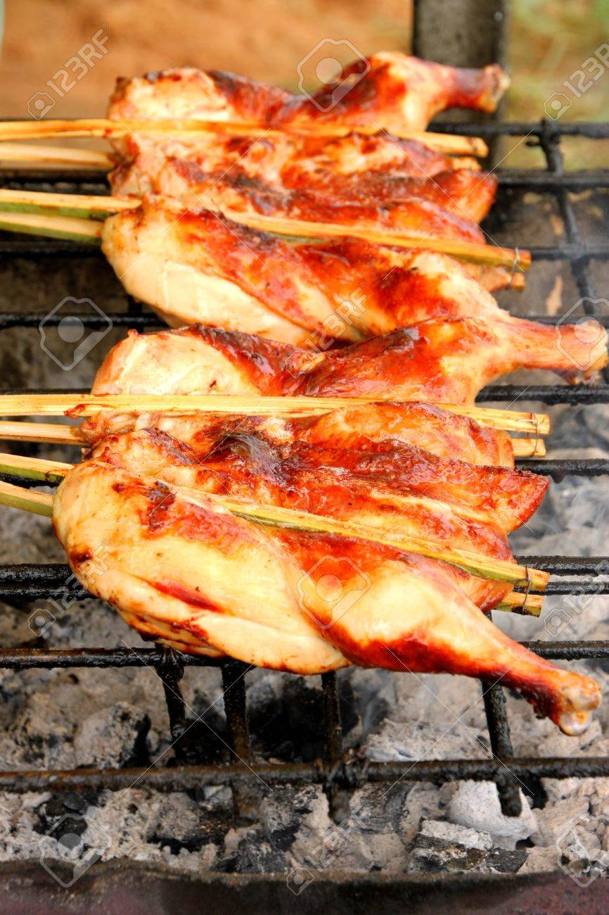 Grilled chicken over gridiron and low heat from natural charcoal Stock Photo - 10848406