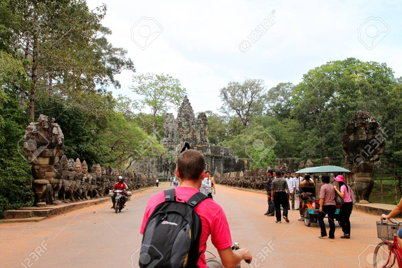 SIEMREAP, KHMER REPUBLIC - NOVEMBER 6 : The unidentified group of tourists are traveling in Angkor Thom, one of Khmer ancient sanctuaries on November 6, 2011 at Angkor Thom, Siemreap, Khmer Republic. Stock Photo - 11249421