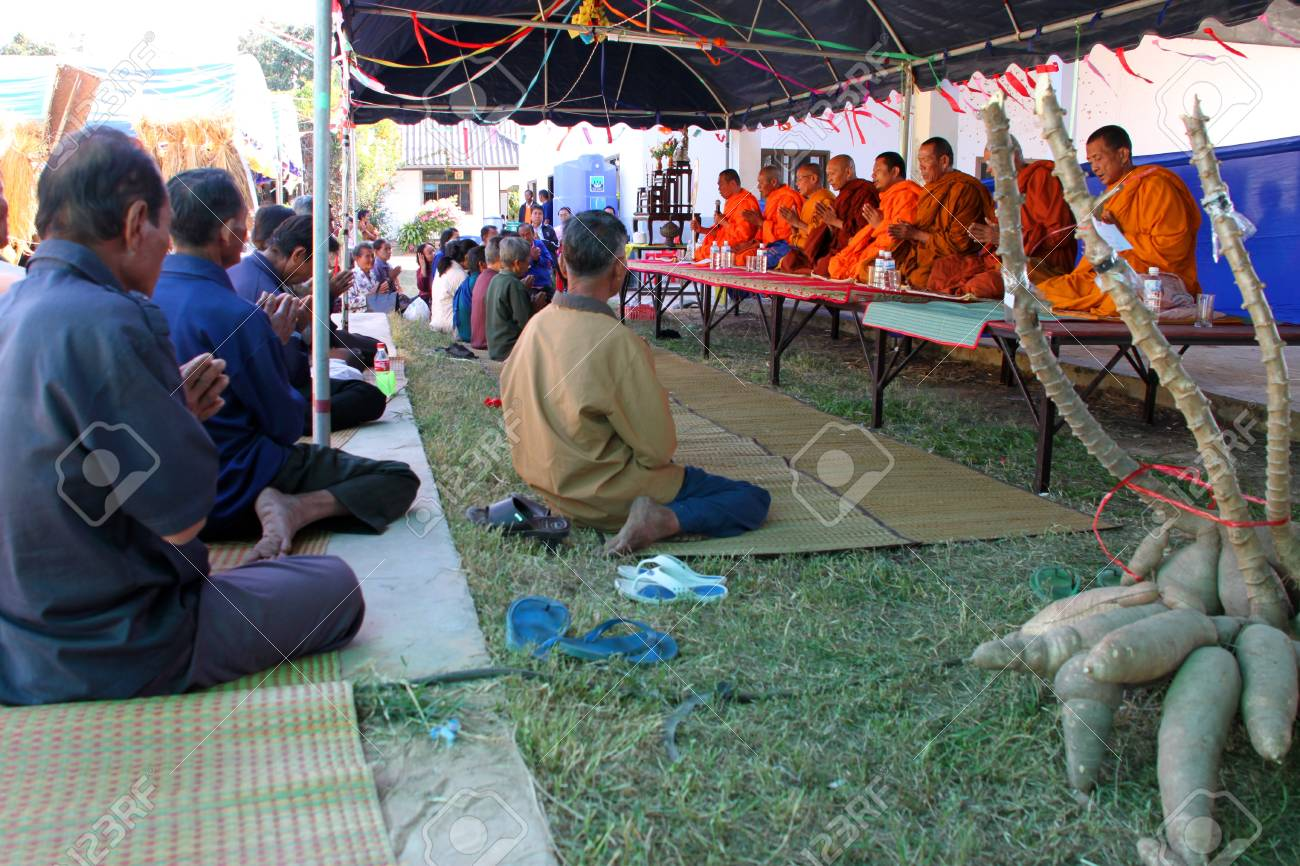 BORABUE, MAHASARAKHAM - JANUARY 6 : The unidentified buddhists are listening to a monks sermon in Rice Celebration Festival on January 6, 2012 at Borabue Local Administration Plaza, Borabue, Mahasarakham, Thailand. Stock Photo - 11817631