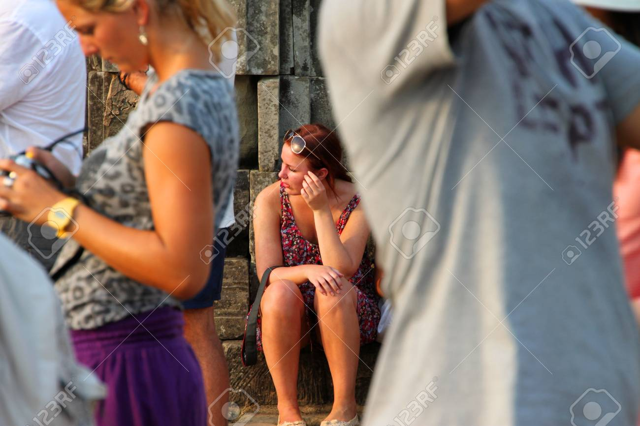 SIEMREAP, KHMER REPUBLIC - FEBRUARY 11 : The unidentified tourists are waiting to see sunset on February 11, 2012 at Phnom Bakheng mountain, Siemreap, Khmer Republic. Stock Photo - 12385587