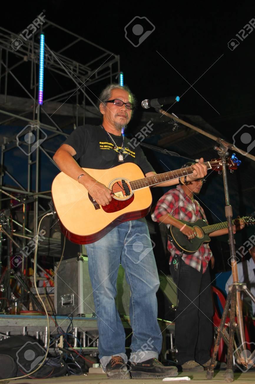 YANGSISURAT, MAHASARAKHAM, THAILAND - MARCH 22 : Mr.Nhga Caravan is performing local song in religious merit concert on March 22, 2012 at Ban Nong Bua Santu, Yangsisurat, Mahasarakham, Thailand. Stock Photo - 13257422