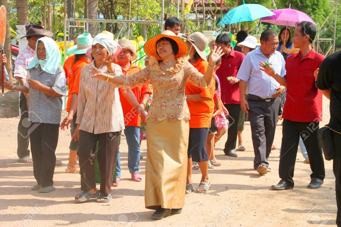 YANGSRISURAT, MAHASARAKHAM - MARCH 22 : Unidentified close relatives are in procession of ordination ceremony on March 22, 2012 at Wat Nongbuasantu, Yangsrisurat, Mahasarakham, Thailand. Stock Photo - 13491322