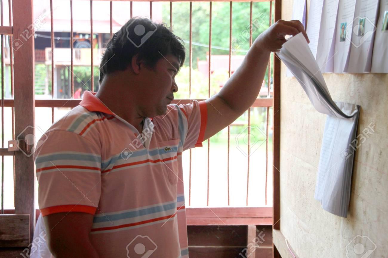 MUANG, MAHASARAKHAM - SEPTEMBER 7 : Unidentified voter is checking information for voting village headman on September 7, 2012 at Wat Ban Jam Nak, Nong Pling, Muang, Mahasarakham, Thailand. Stock Photo - 15102431