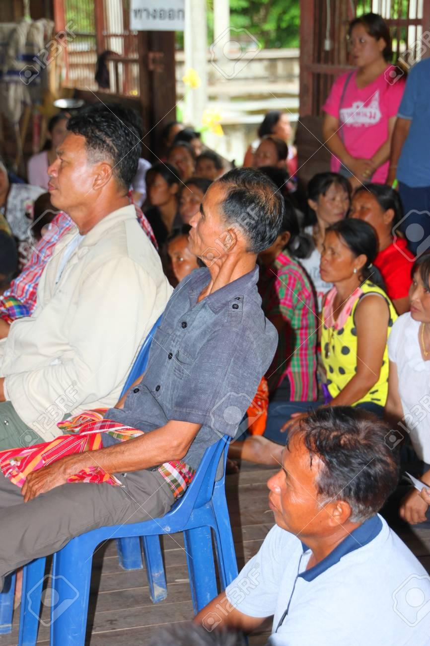 MUANG, MAHASARAKHAM - SEPTEMBER 7 : Unidentified voters are seeing officers counting votes village headman on September 7, 2012 at Wat Ban Jam Nak, Nong Pling, Muang, Mahasarakham, Thailand. Stock Photo - 15102435