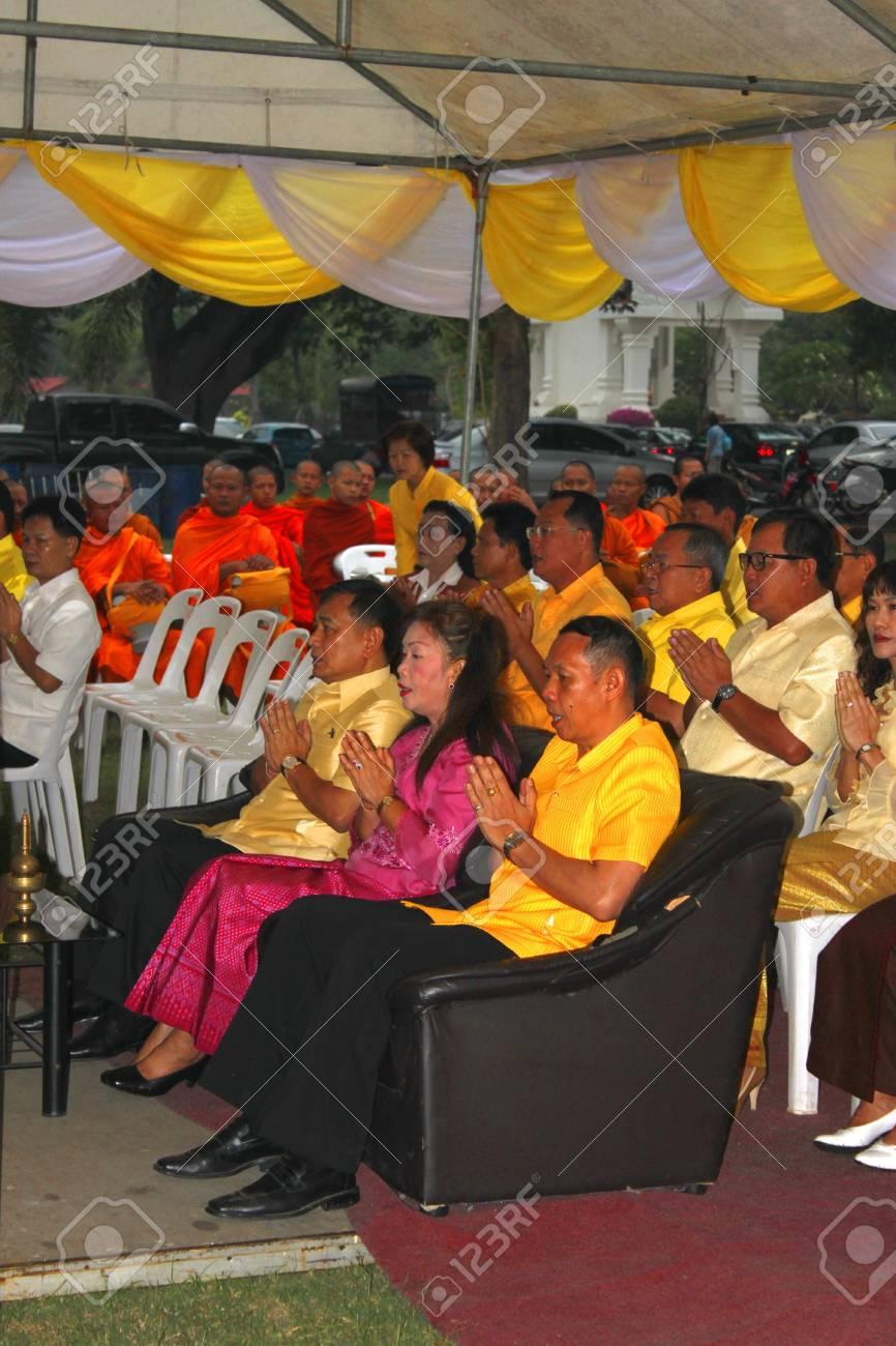 MUANG, MAHASARAKHAM - DECEMBER 5 : Provincial governor, Mr.Noppawat Singhsakda and people are making religious merit and celebrating the king Rama IX birthday on December 5, 2012 at city hall ground, Muang, Mahasarakham, Thailand. Stock Photo - 17118484