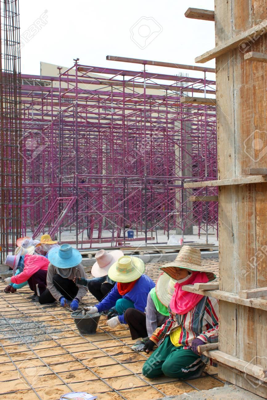 MUANG, BURIRAM - JANUARY 26 : Unidentified workers are working on construction site on January 26, 2013 at Taweekit Plaza Supermarket, Muang, Buriram, Thailand. Stock Photo - 17679316