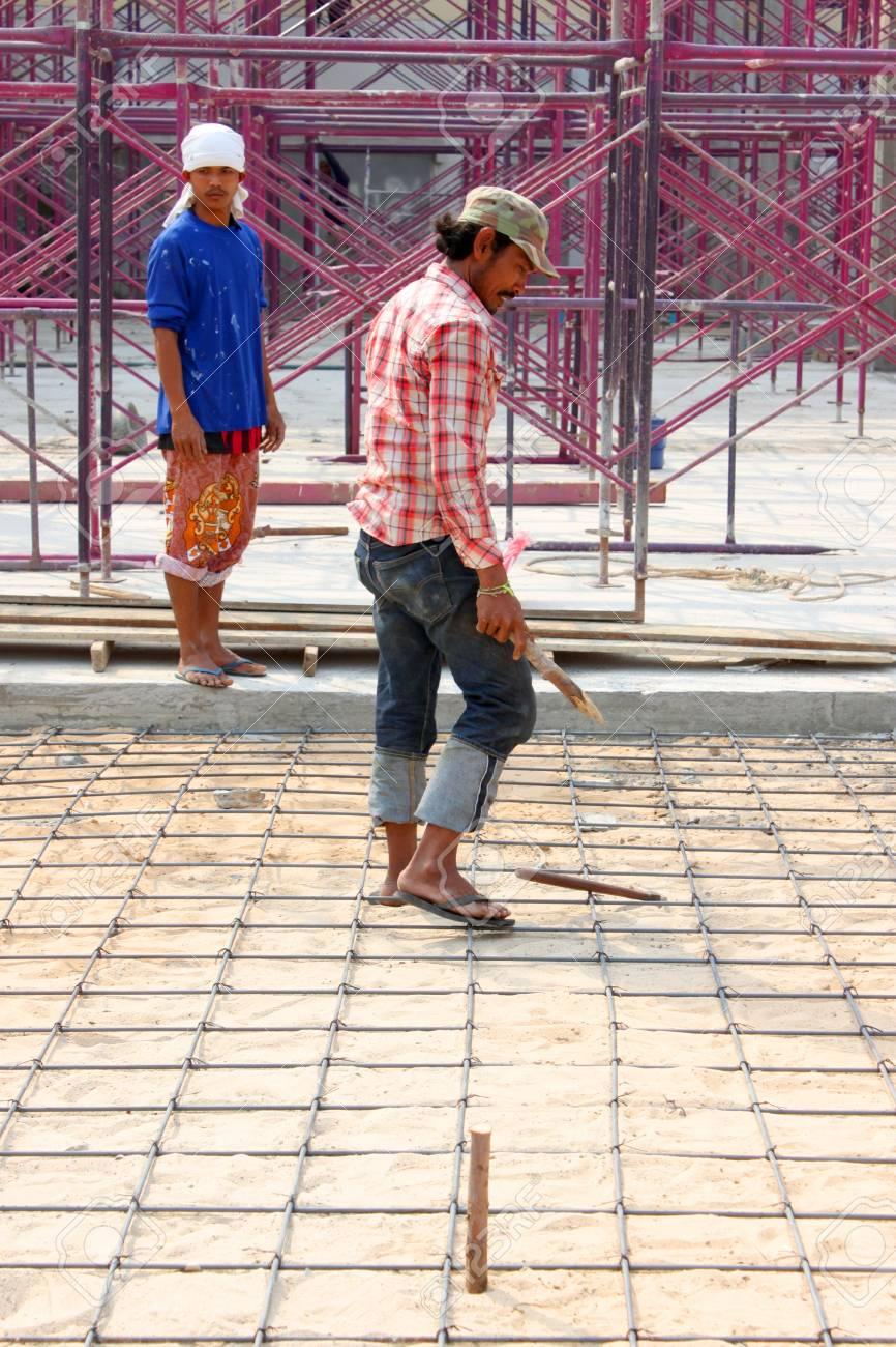 MUANG, BURIRAM - JANUARY 26 : Unidentified workers are working on construction site on January 26, 2013 at Taweekit Plaza Supermarket, Muang, Buriram, Thailand. Stock Photo - 17679307