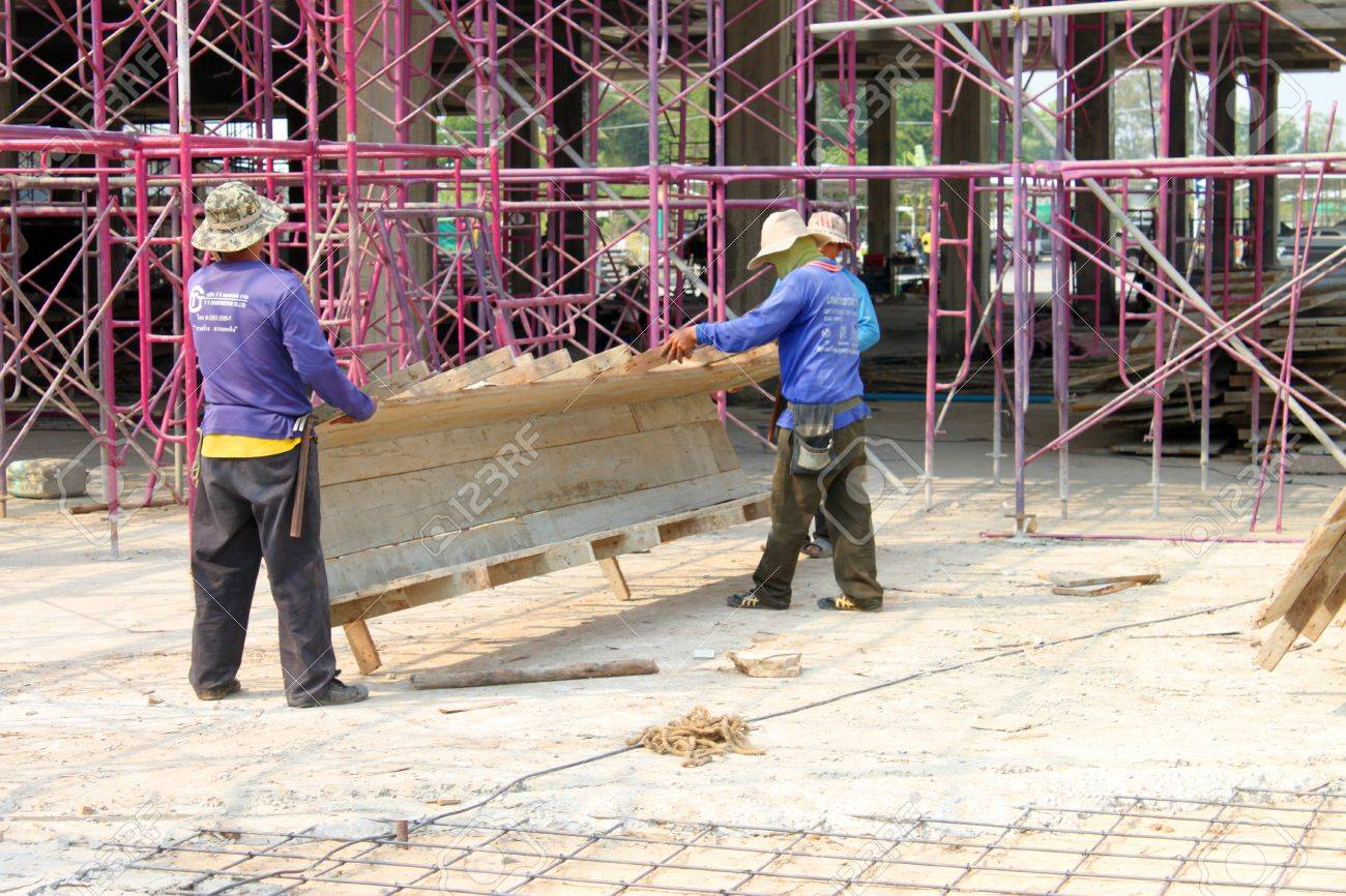 MUANG, BURIRAM - JANUARY 26 : Unidentified workers are working on construction site on January 26, 2013 at Taweekit Plaza Supermarket, Muang, Buriram, Thailand. Stock Photo - 17679308