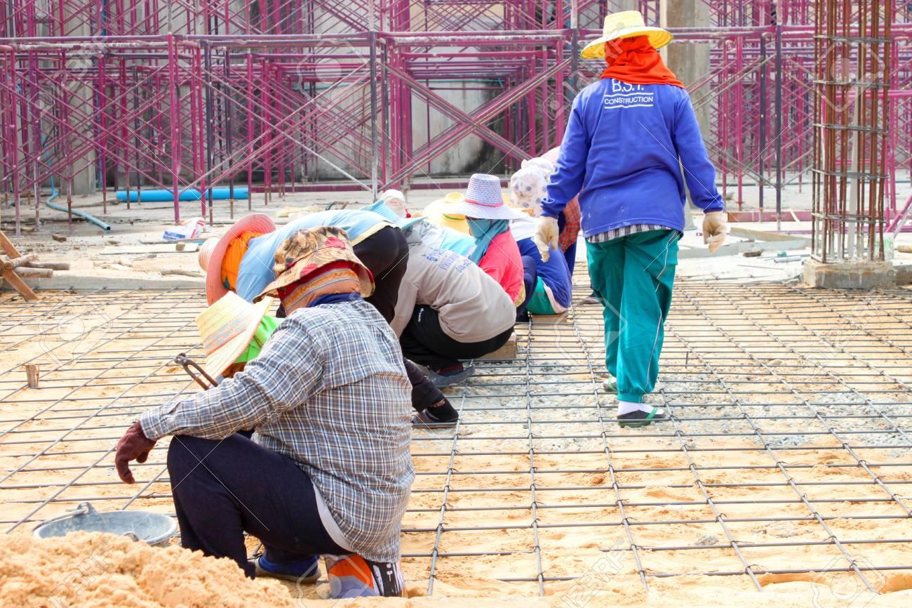 MUANG, BURIRAM - JANUARY 26 : Unidentified workers are working on construction site on January 26, 2013 at Taweekit Plaza Supermarket, Muang, Buriram, Thailand. Stock Photo - 17712716
