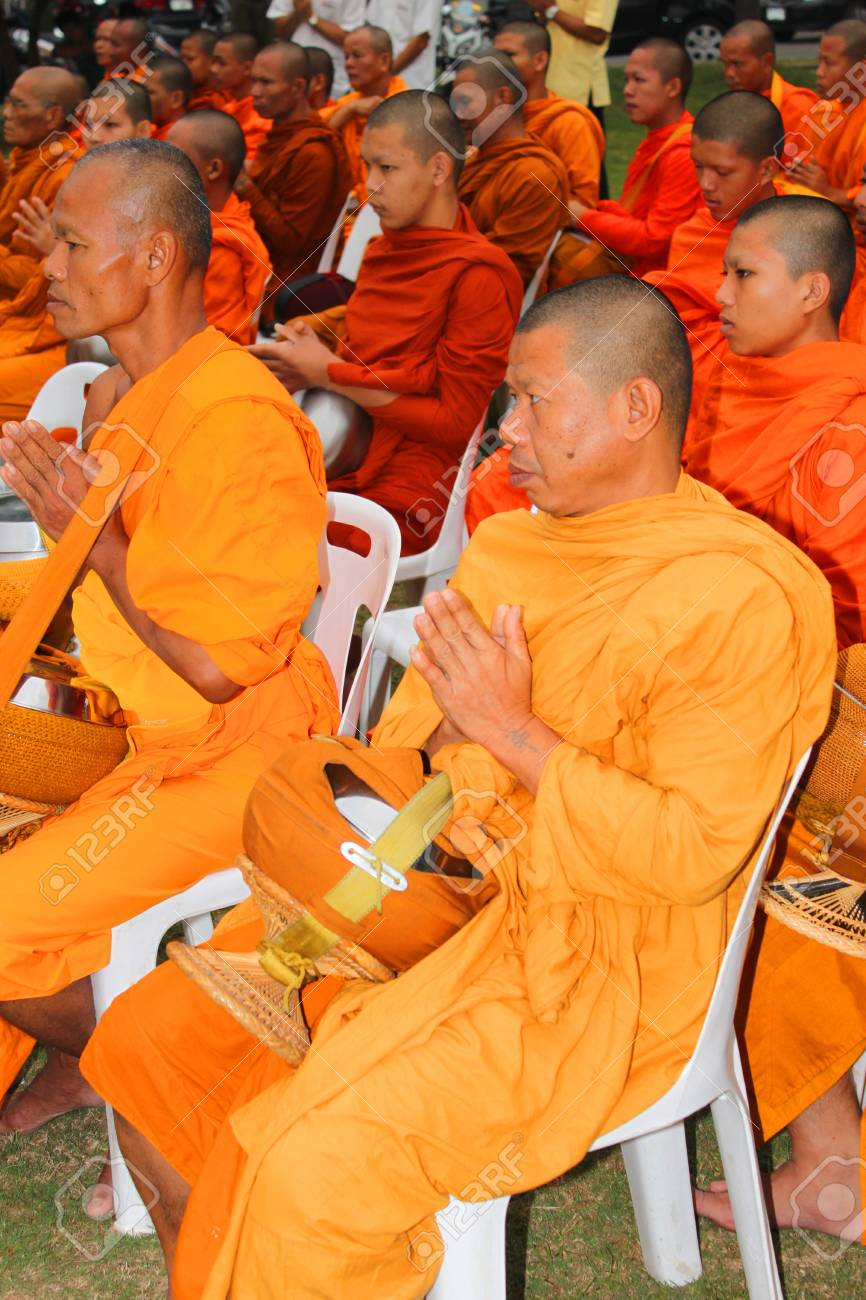 MUANG, MAHASARAKHAM - DECEMBER 5 : Unidentified monks are making religious merit and celebrating the king Rama IX birthday on December 5, 2012 at city hall ground, Muang, Mahasarakham, Thailand. Stock Photo - 17712771