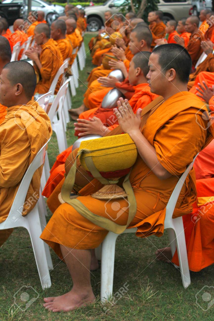 MUANG, MAHASARAKHAM - DECEMBER 5 : Unidentified monks are making religious merit and celebrating the king Rama IX birthday on December 5, 2012 at city hall ground, Muang, Mahasarakham, Thailand. Stock Photo - 17712784