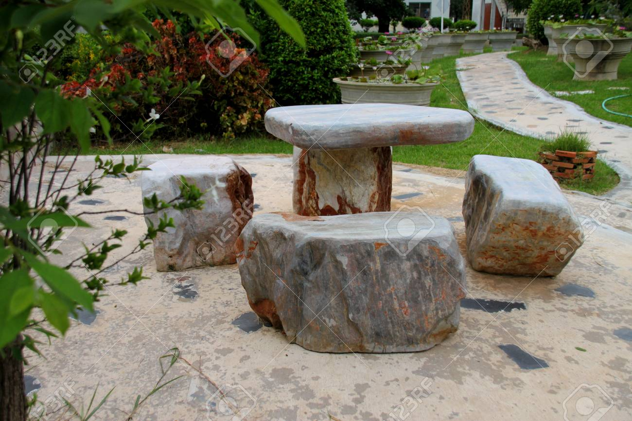 Marble stone furniture in tropical garden stock photo 106127529
