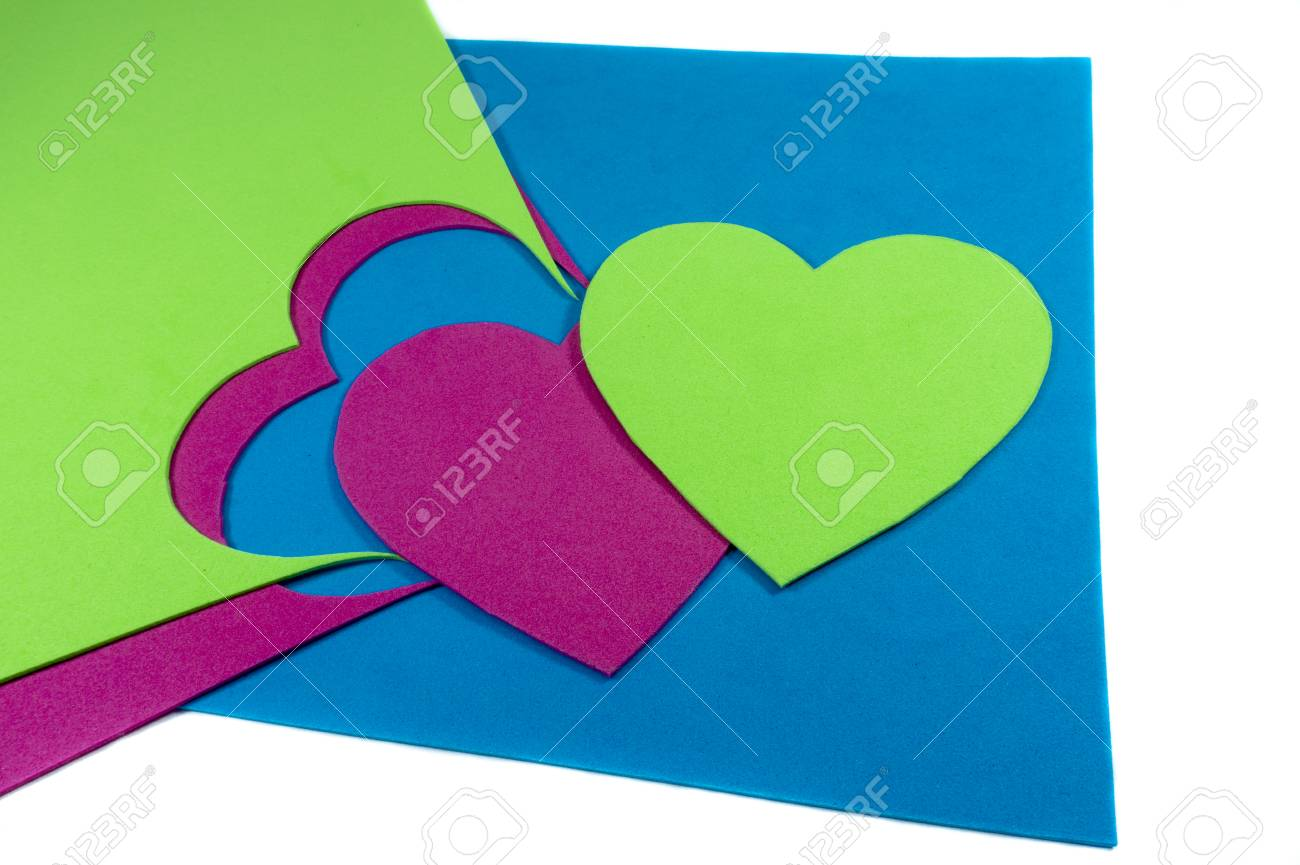 Hearts cut out of bright color foam sheets viewed in full frame