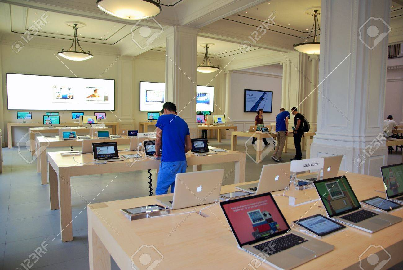 AMSTERDAM, NETHERLANDS - JUNE 28: Inside the Apple Store on June 28, 2012 in Amsterdam, Netherland. The new Apple Store in Amsterdam opened March 5, 2012, the first official one in the Netherlands - 15669702