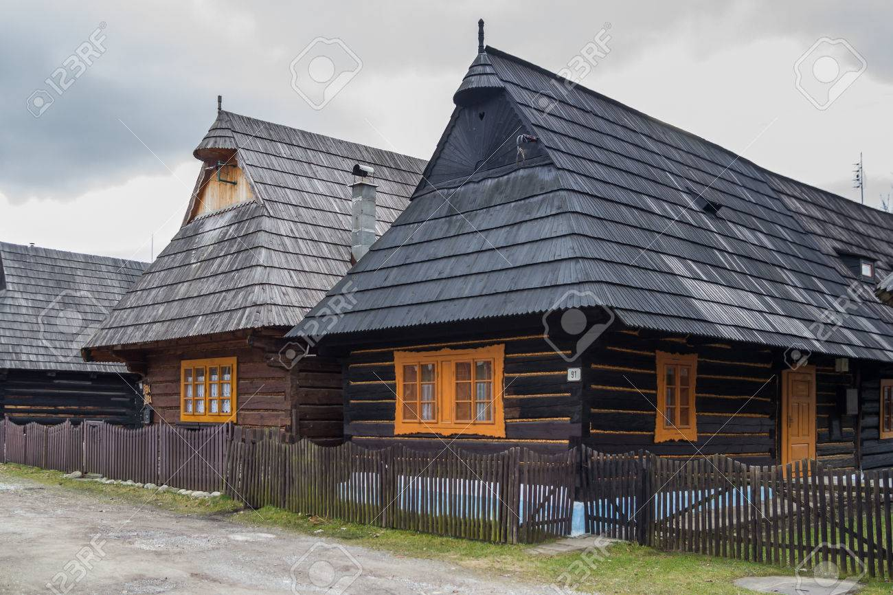 Row of traditional style wooden houses with tiled roofs - 79638068