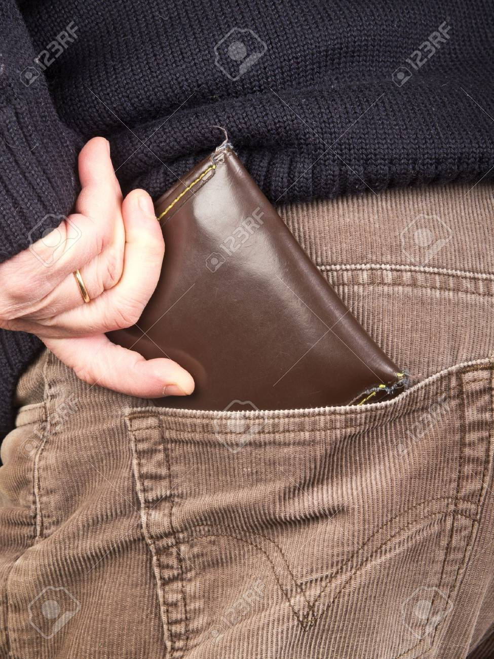 hand taking wallet from the pocket Stock Photo - 12229808