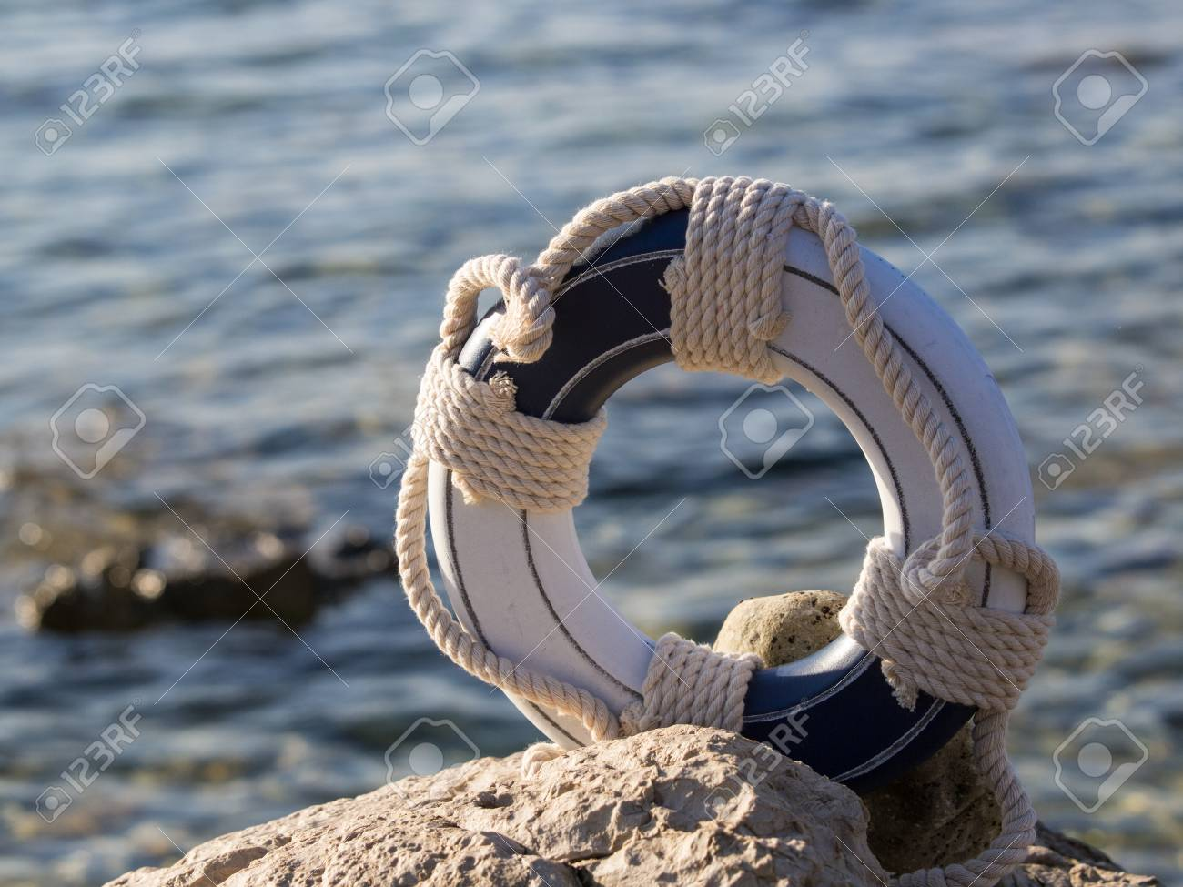safe belt on the stone near the sea Stock Photo - 15414053