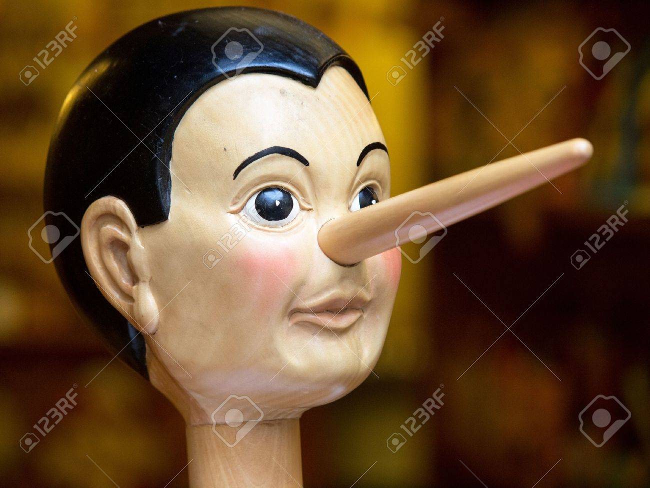 Wooden pinocchio doll with his long nose - 16240527