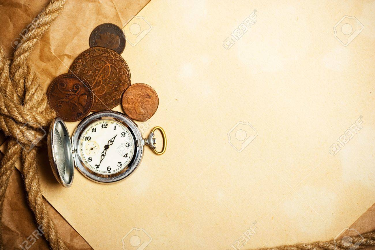 antique watch and money with rope on old yellow paper Stock Photo - 10677484