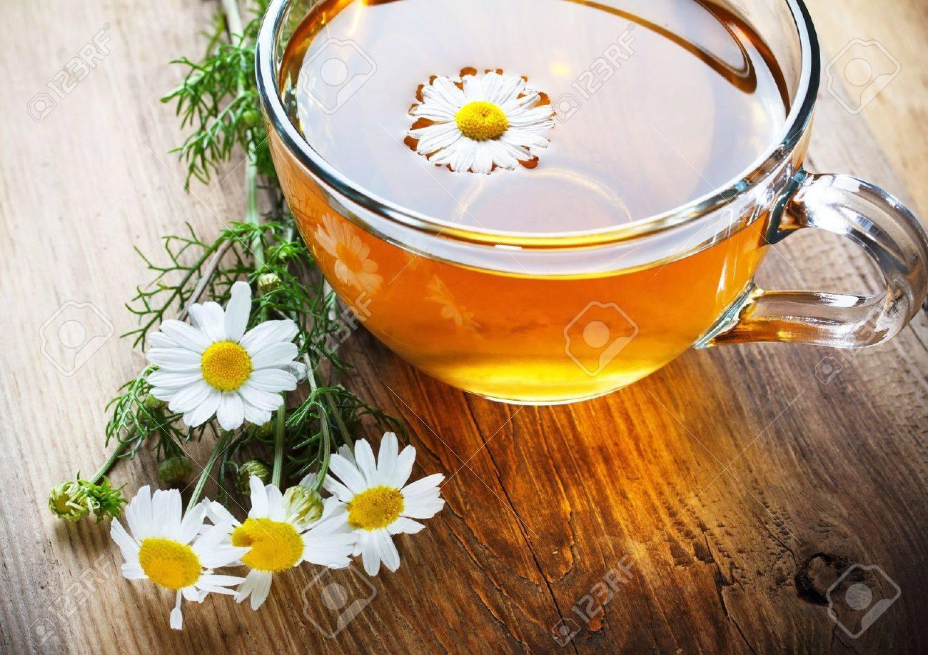 chamomile tea on wooden table Stock Photo - 12828329