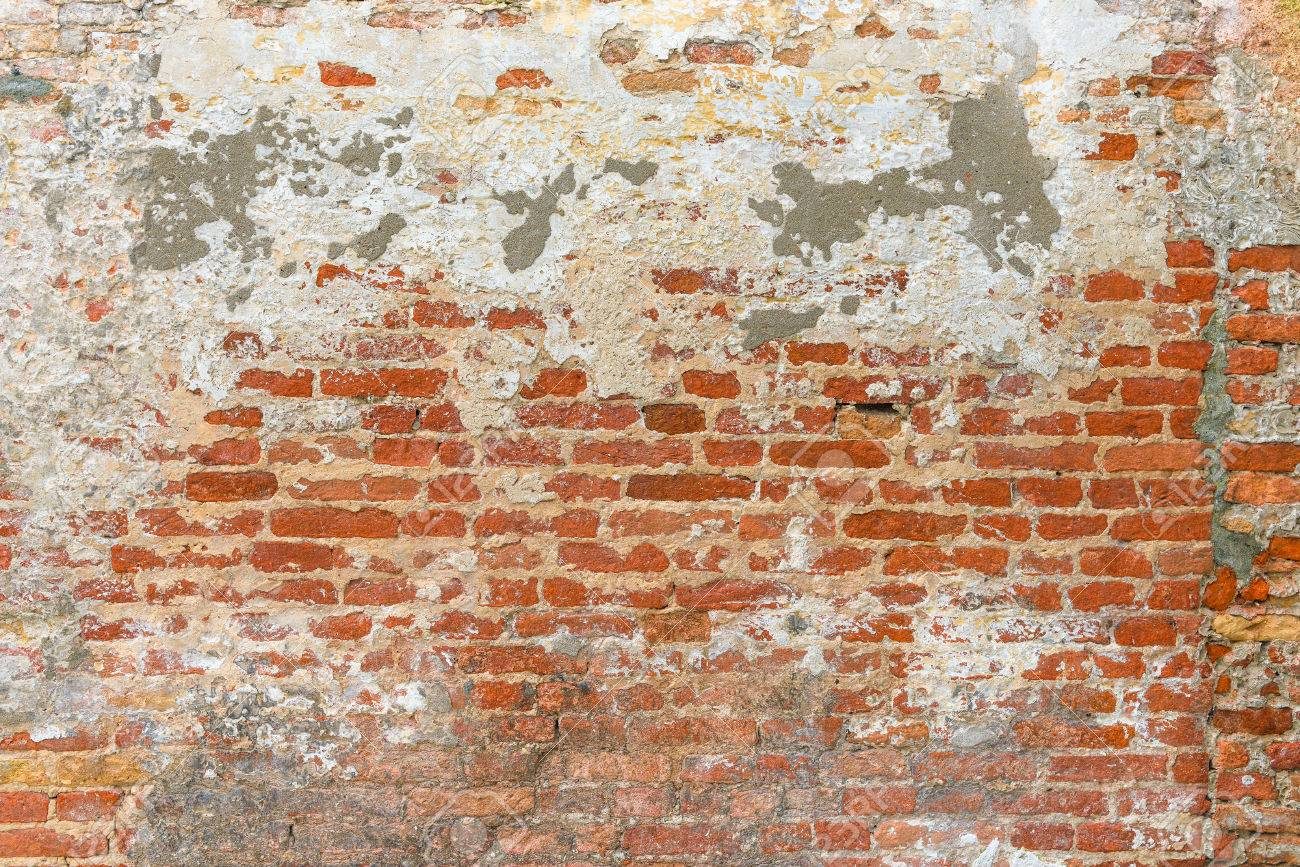Old Brick Wall Texture Covered With Multiply Stucco Plaster