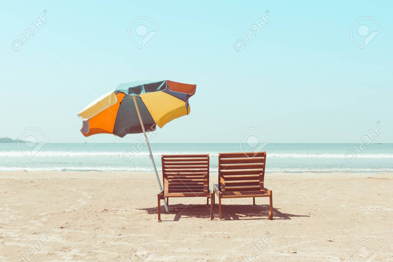 Vintage Toned Two Beach Chairs And Umberella On Empty Tropical Stock Photo Picture And Royalty Free Image Image 77616795