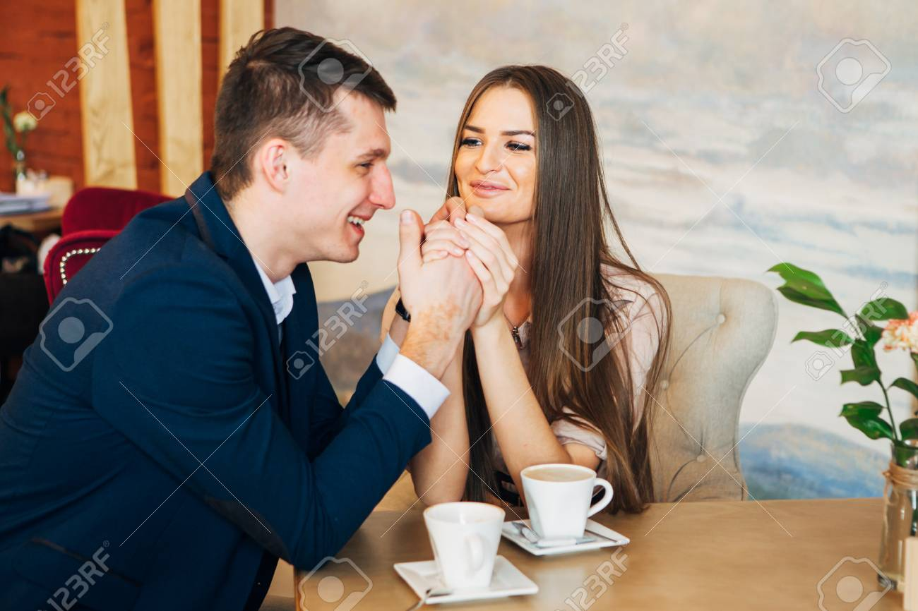Happy young couple taking selfie with smart phone at cafe - 97567336