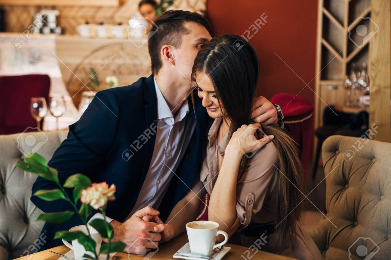 Happy young couple taking selfie with smart phone at cafe - 97567345
