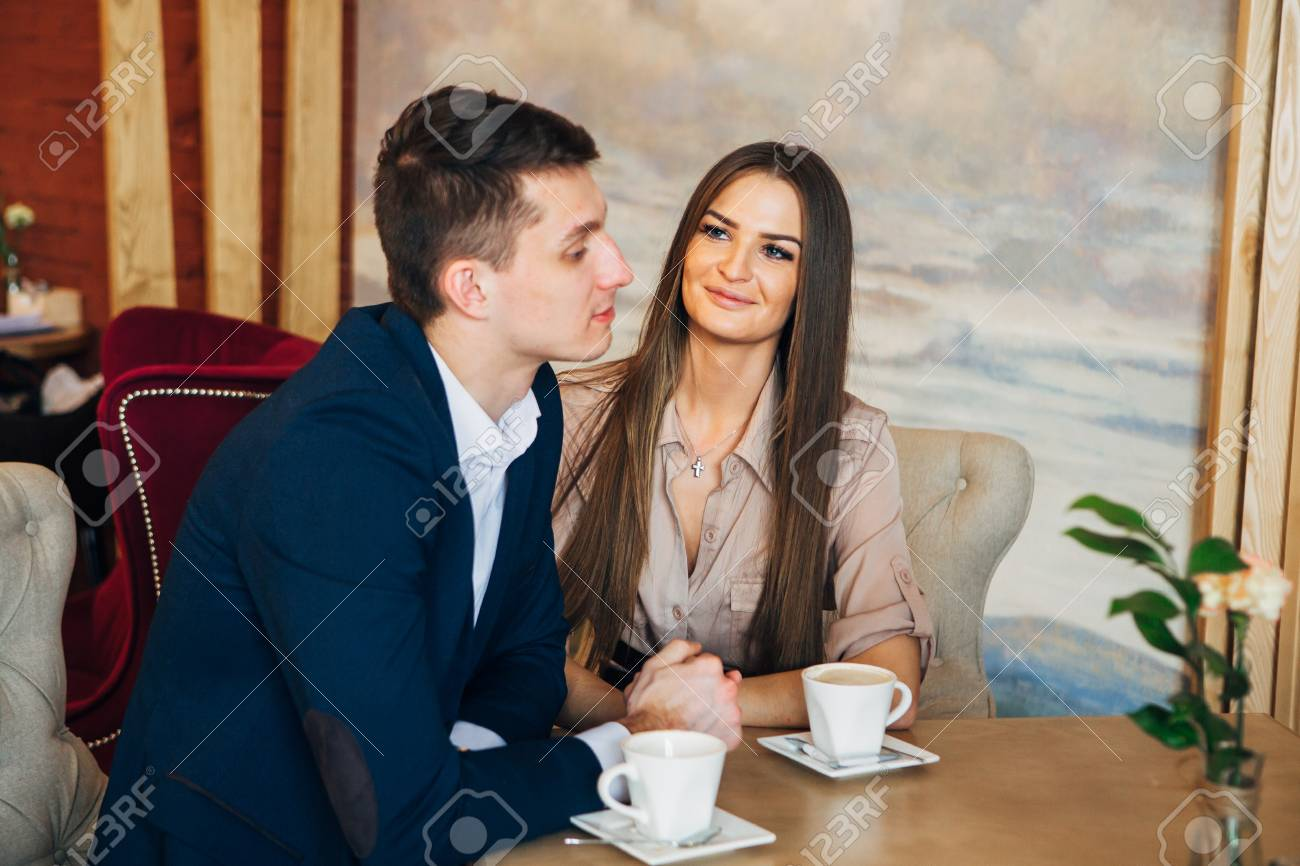 Happy young couple taking selfie with smart phone at cafe - 97567348