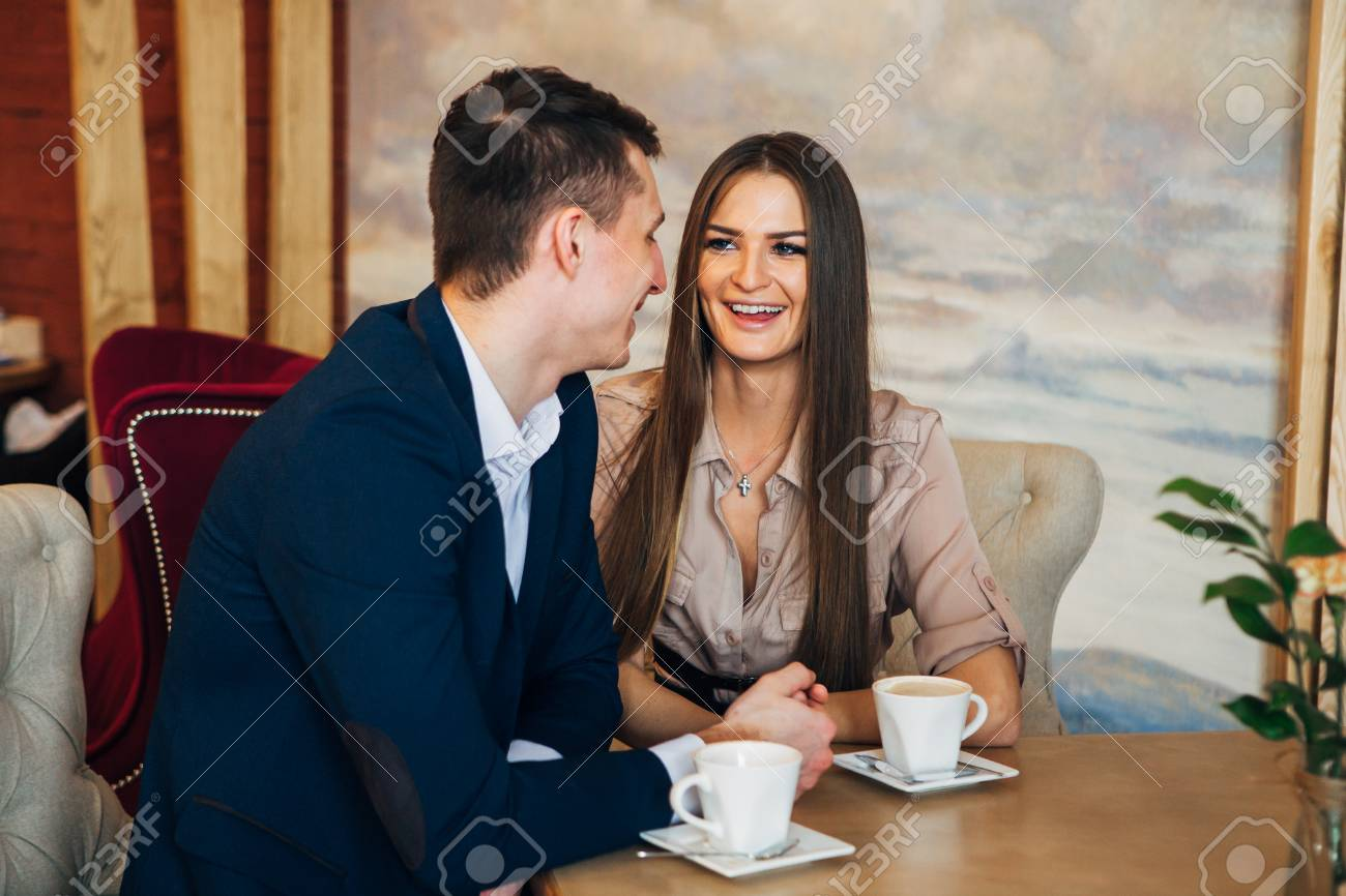 Happy young couple taking selfie with smart phone at cafe - 97567354