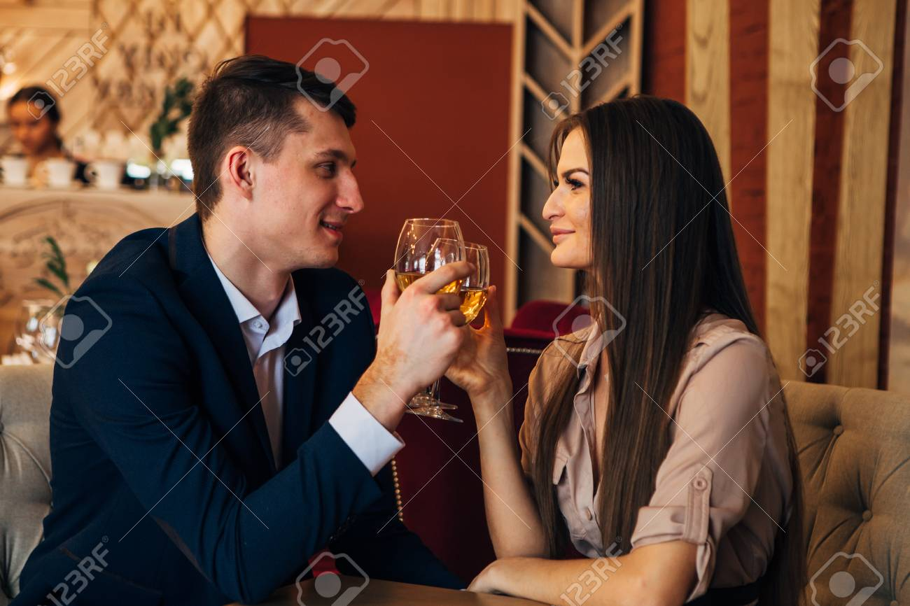Dating concept, couple drinking wine in a restaurant - 97567466