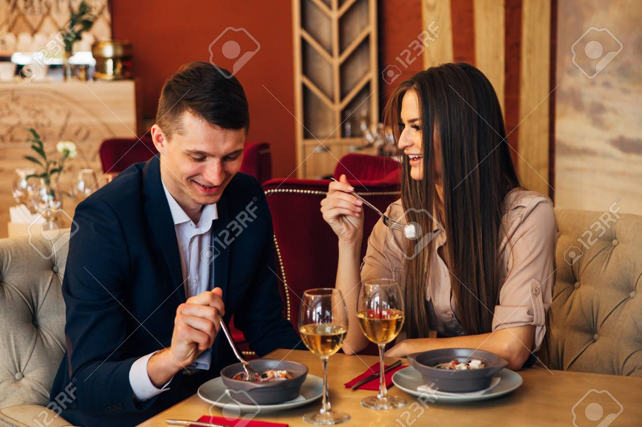 Dating concept, couple drinking wine in a restaurant - 97567468