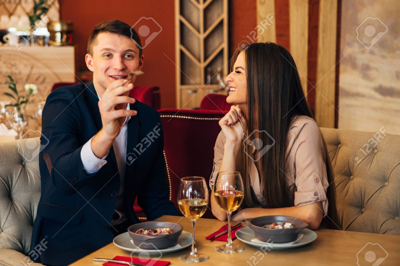Dating concept, couple drinking wine in a restaurant - 97567472