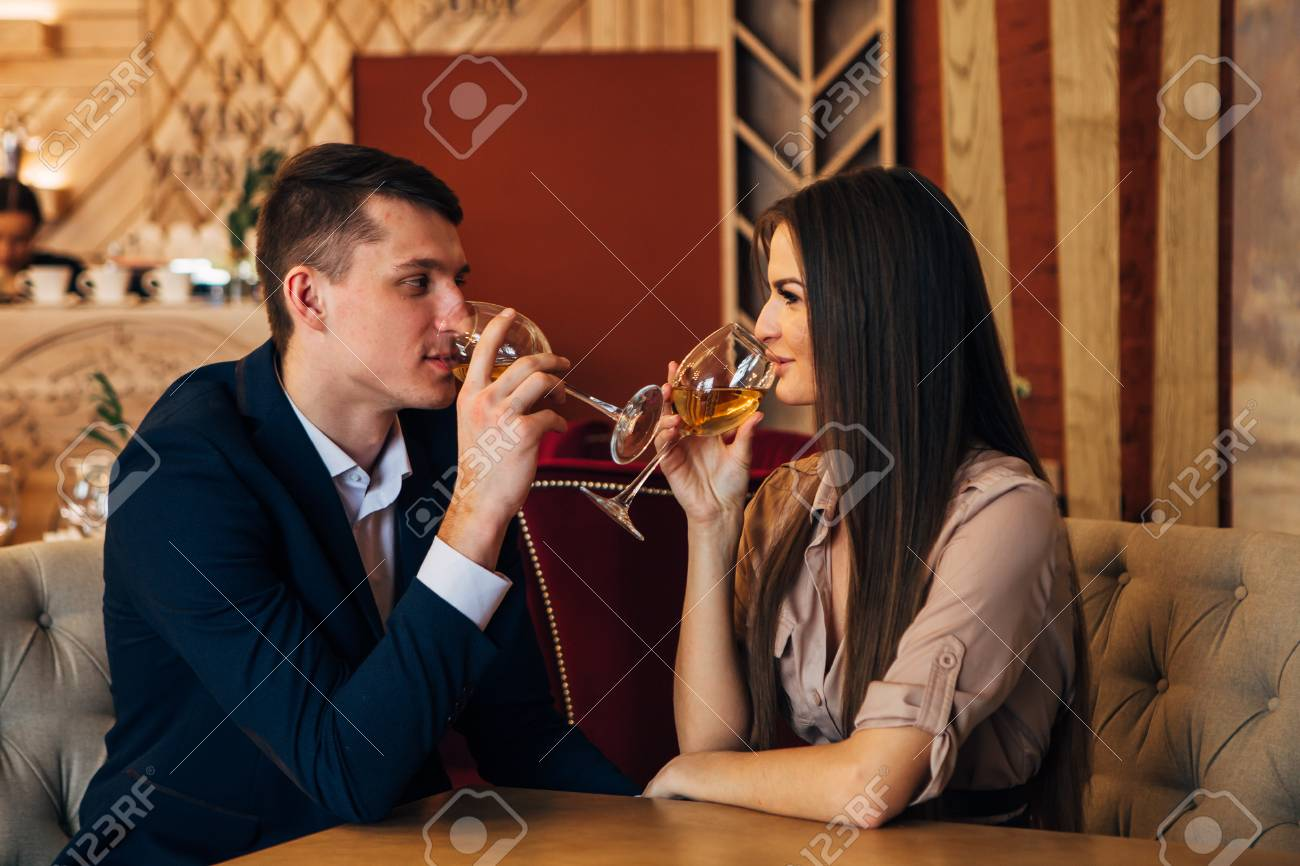 Dating concept, couple drinking wine in a restaurant - 97567477