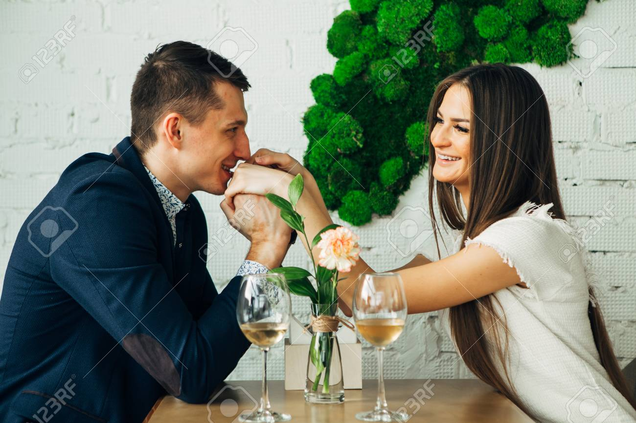 Couple celebrate Valentines day with romantic dinner in restaurant - 97567482