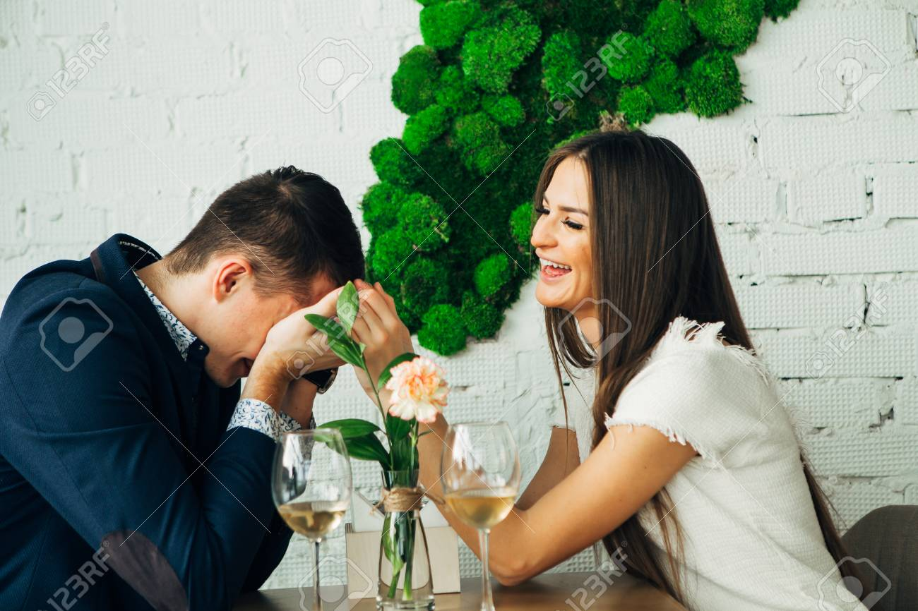Couple celebrate Valentines day with romantic dinner in restaurant - 97567483