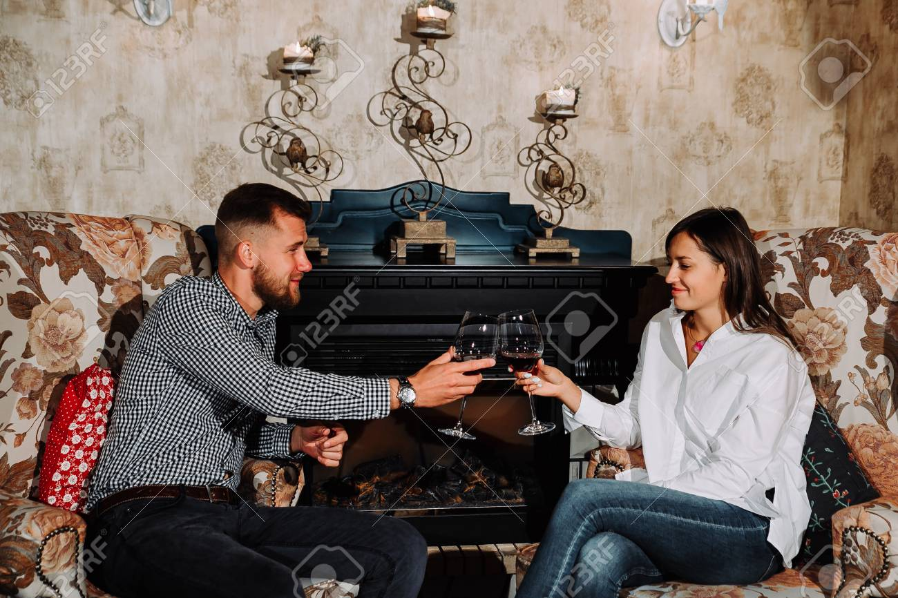 Special moments together. Beautiful young woman in love toasting her glass with her boyfriend at the dinner in the local restaurant - 104670893