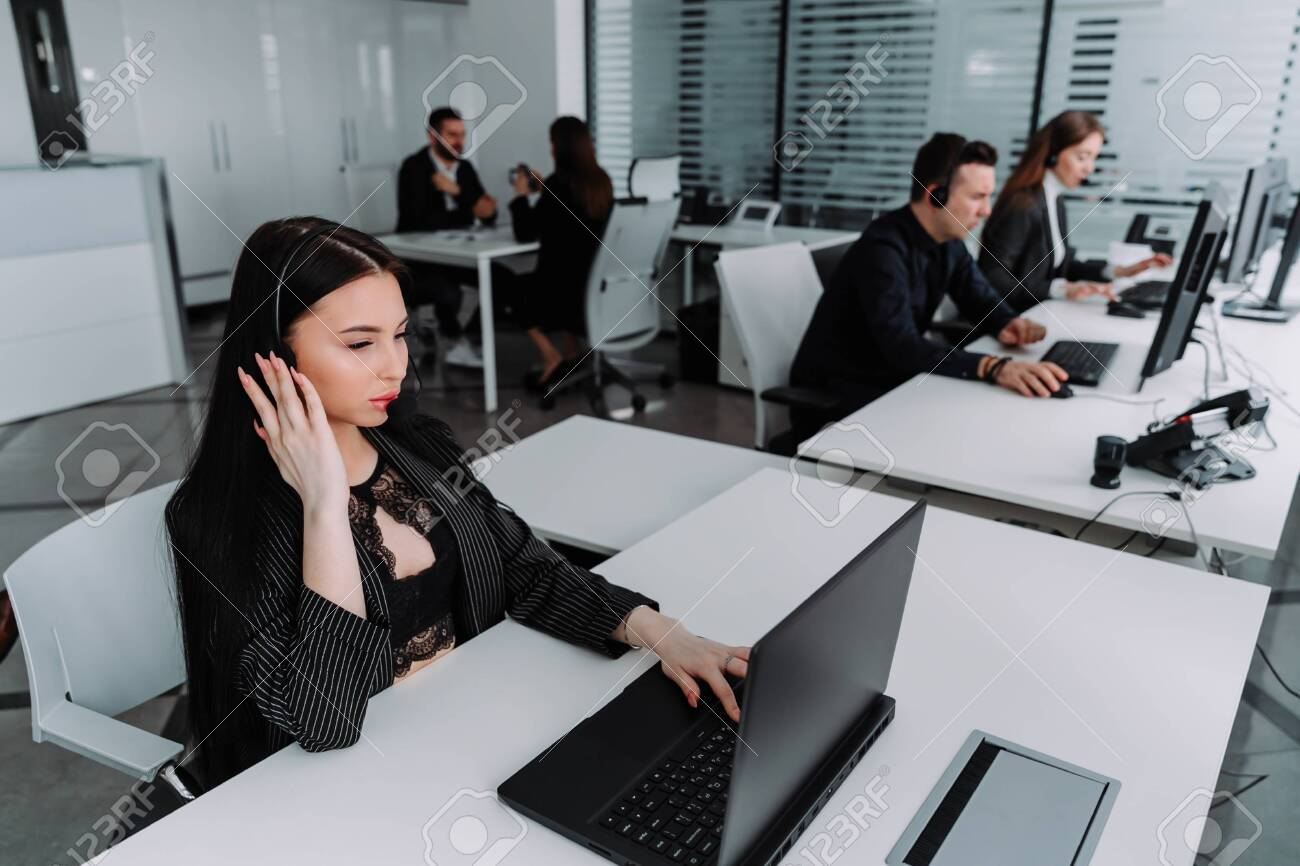 A team of business people working in a call center on the line. - 143173696