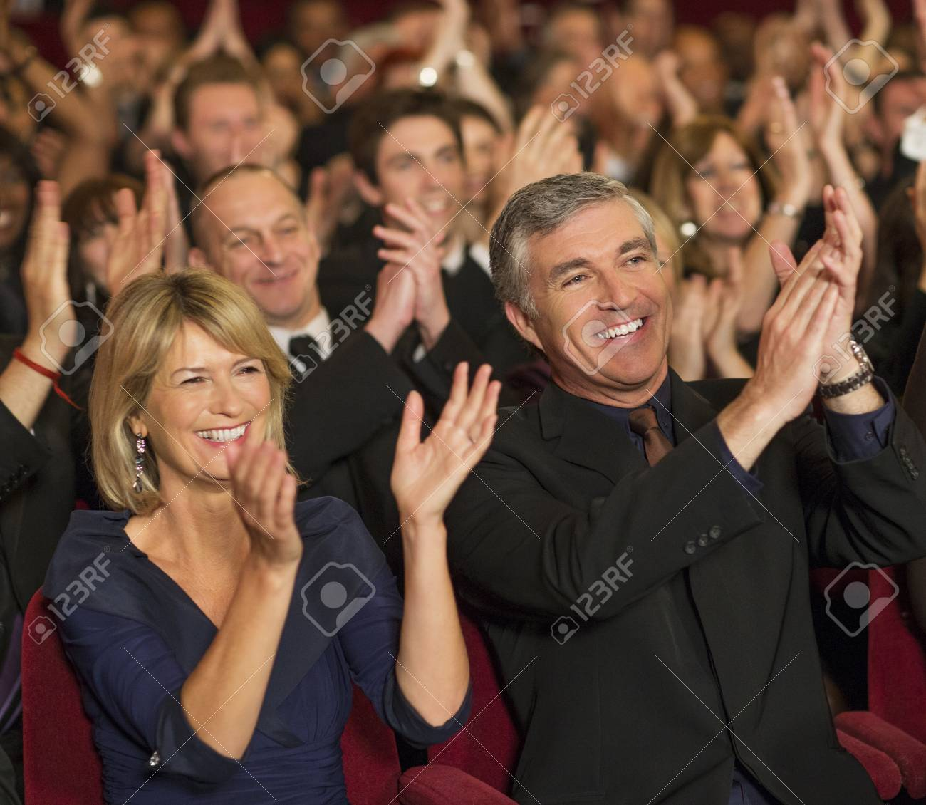 enthusiastic theater audience clapping stock photo picture and