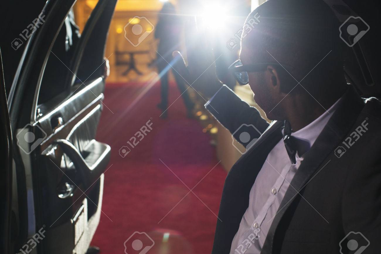 Celebrity In Limousine Arriving At Red Carpet Event And Waving