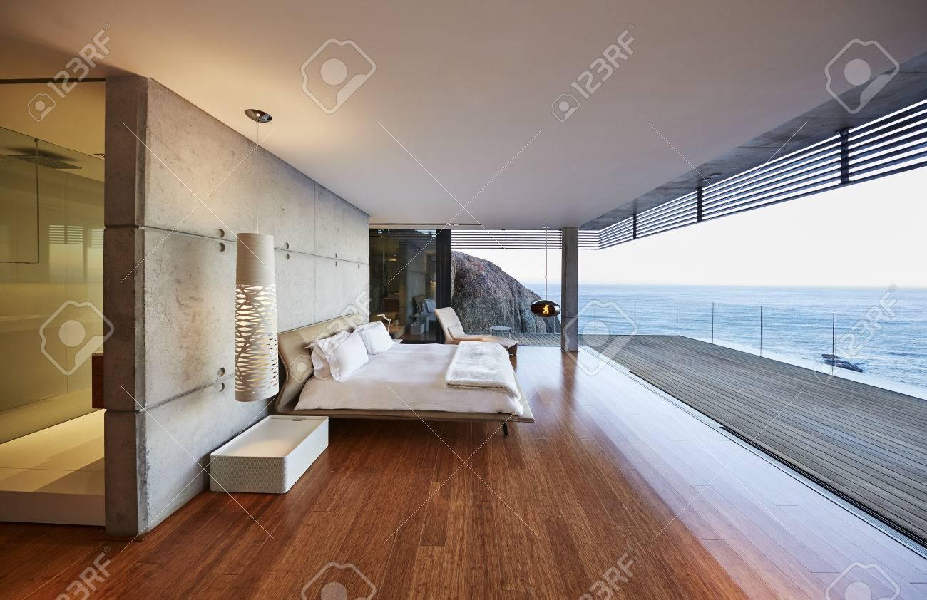 Modern Luxury Bedroom Open To Patio With Ocean View Stock Photo